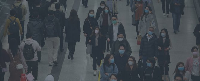 Asian travelers wearing facemasks because of coronavirus concerns.